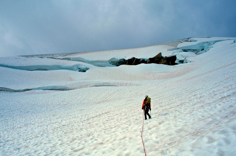 Glacier travel on soft snow. Crevasses ahead.